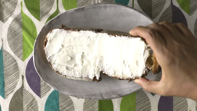 having breakfast with cream cheese on a slice of bread - table top view stock videos & royalty-free footage