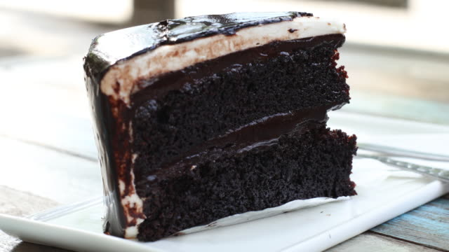 Having chocolate cake in a cafe. Front view
