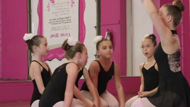 having fun at dance class - leg warmers stock videos & royalty-free footage