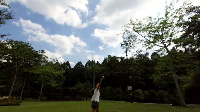 having fun flying my kite - malay family stock videos and b-roll footage