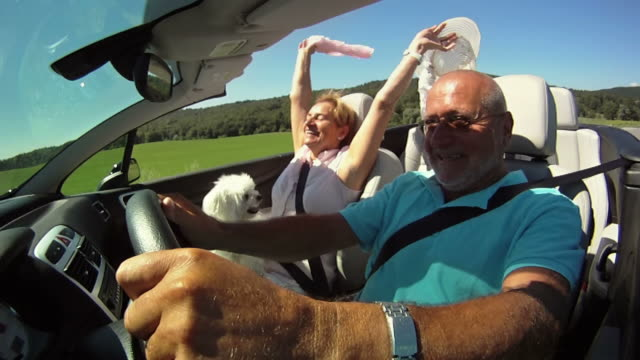 hd slow-motion: having fun in a convertible - husband stock videos & royalty-free footage