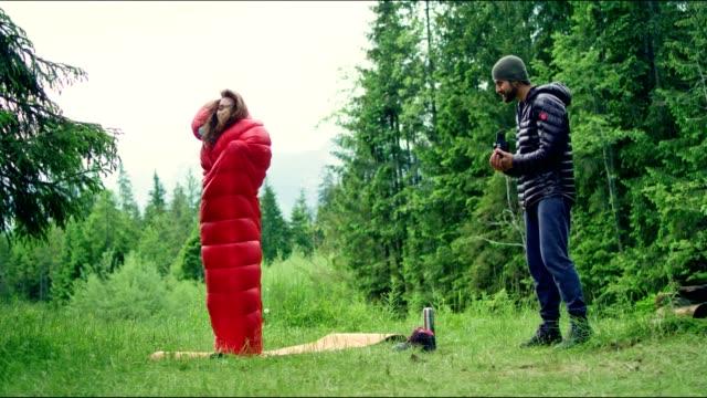 having fun in a sleeping bag - femininity photos stock videos & royalty-free footage