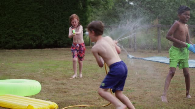 having fun in summer - water fight stock videos & royalty-free footage