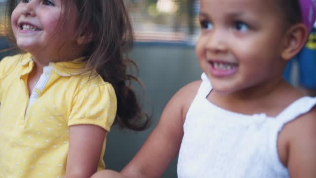 vídeos de stock, filmes e b-roll de se divertindo no trampolim - parque infantil