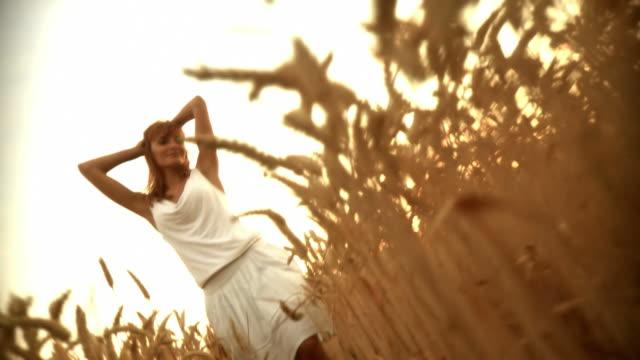 hd: having fun in wheat - white dress stock videos & royalty-free footage