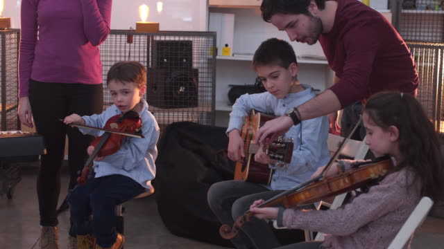 having fun learning how to play musical intruders - violin stock videos & royalty-free footage