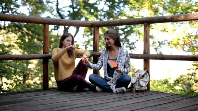 Having fun on a log cabin terrace