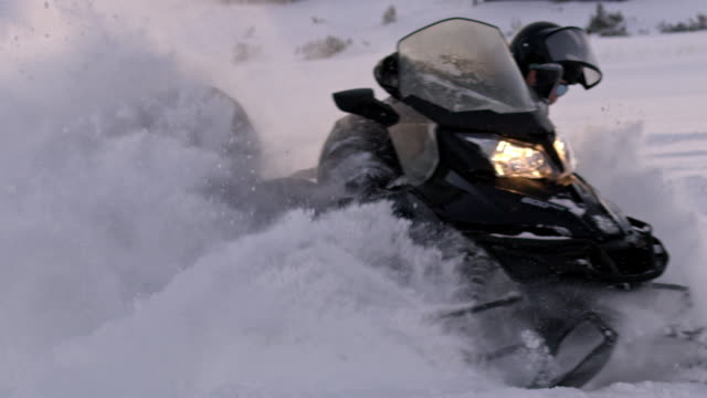 slo mo having fun speeding with a snowmobile - sunny stock videos & royalty-free footage