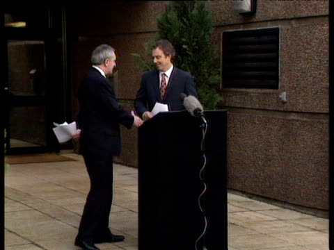 vídeos y material grabado en eventos de stock de having held talks on good friday agreement tony blair shakes hand of irish prime minister bertie ahern northern ireland 10 apr 98 - 1998