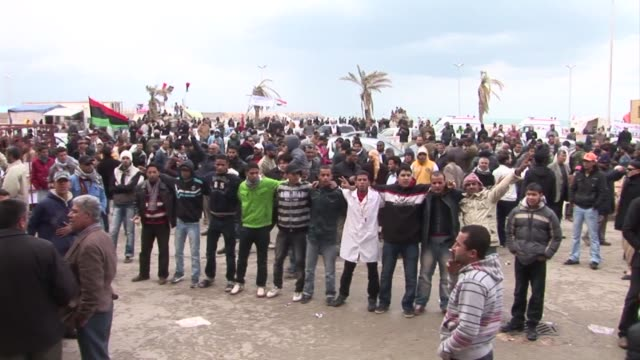 having held the city for over a week residents in the eastern libyan city of benghazi sang songs and mourned those killed in the uprising that saw... - libyan civil war stock videos & royalty-free footage