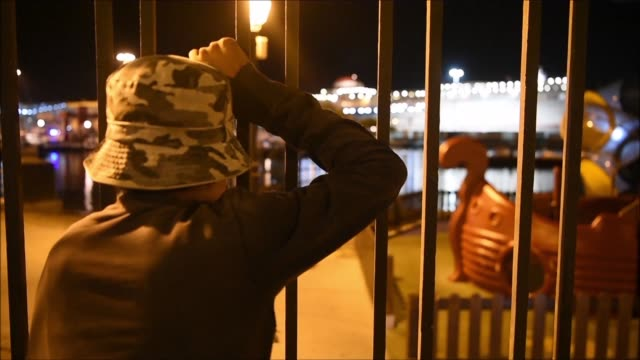 Having left their homes due to precarious social circumstances Moroccan homeless youth migrants attempt to travel to Europe by jumping on the back of...