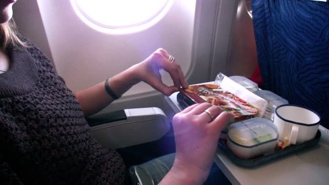 having lunch in airplane - tray stock videos and b-roll footage