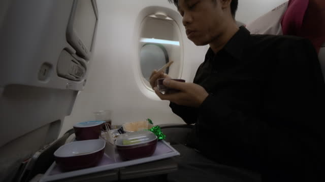 having lunch in airplane - medium group of objects stock videos & royalty-free footage