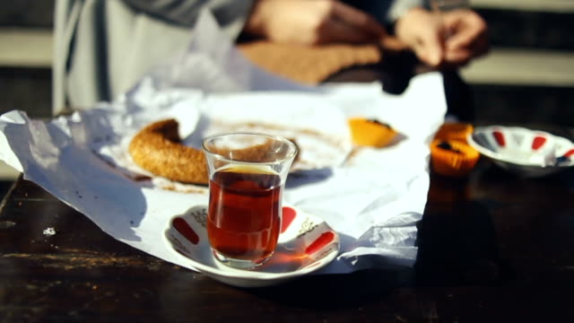 having traditional turkish breakfast, simit bagel and tea with olives - eminonu district stock videos and b-roll footage