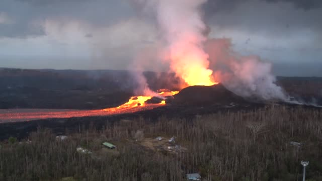 hawaii army national guard conduct an aerial survey of the kilauea eruption starting with fissure eight that has developed a sizable cone it is... - lava stock videos & royalty-free footage