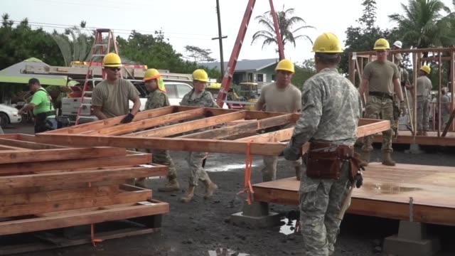 Hawaii Army National Guard soldiers of the 230th Vertical Engineer Company working along side local organizations to help build microshelters for...