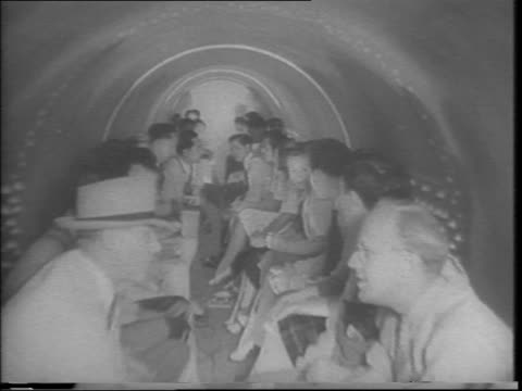 hawaii rushes air-raid shelters and puts plane traps on golf courses and fields to prevent japanese planes from landing / view of polo field covered... - bomb shelter stock videos & royalty-free footage