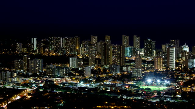 hawaii, view of waikiki hotel and city buildings at night - oahu bildbanksvideor och videomaterial från bakom kulisserna