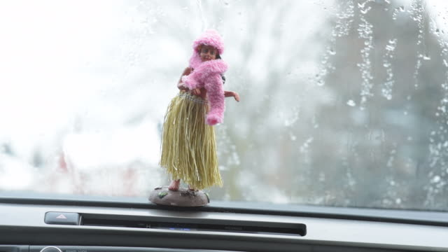 hawaiian hula doll dressed for winter. - ontario canada stock videos & royalty-free footage