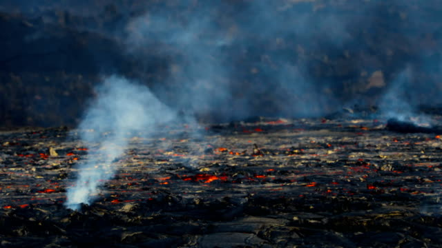 hawaii's kilauea volcano lava flowing rapidly at sanborn quarry. - hawaii islands stock videos & royalty-free footage