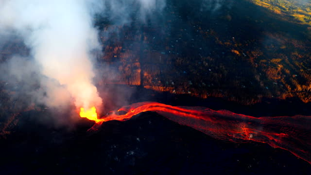 hawaii's kilauea volcano lava flowing rapidly shown from aerial view point - lava stock videos & royalty-free footage