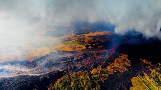 hawaii's kilauea volcano lava flowing rapidly shown from aerial view point - kilauea stock videos & royalty-free footage