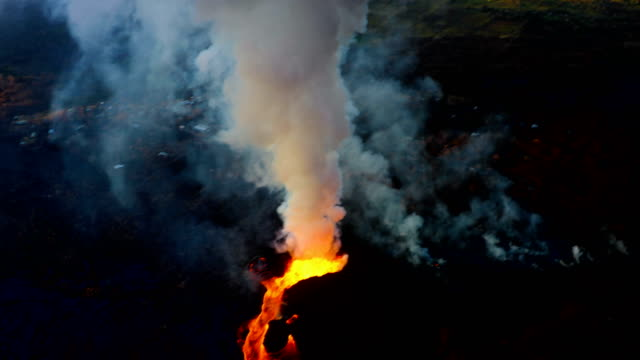 hawaii's kilauea volcano lava flowing rapidly shown from aerial view point. - hawaii islands stock videos & royalty-free footage
