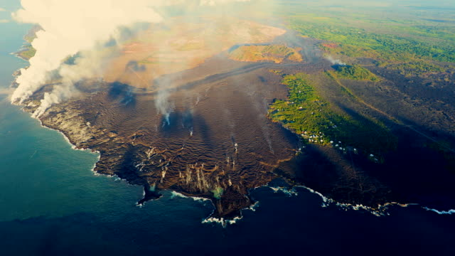 hawaii's kilauea volcano lava flowing rapidly shown from aerial view point - hawaii islands stock videos & royalty-free footage