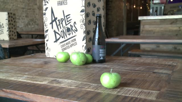 hawkes cidery helping to prevent food waste by using donated apples to make cider; uk, england, london, bermondsey, hawkes cidery; various shots of... - apple fruit stock videos & royalty-free footage