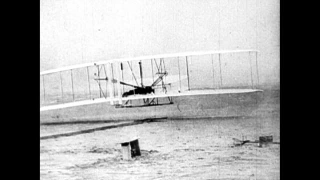 Hawthorne Street / CU four cylinder engine / still photograph of successful flight at Kitty Hawk in 1903 / film of the Wright brothers flight / large...