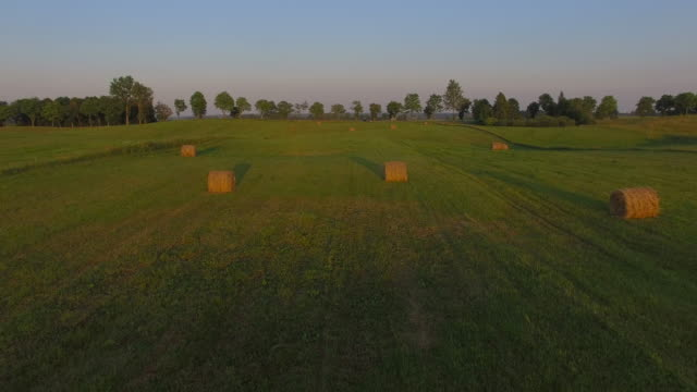 AERIAL: Hay Bales At Sunset