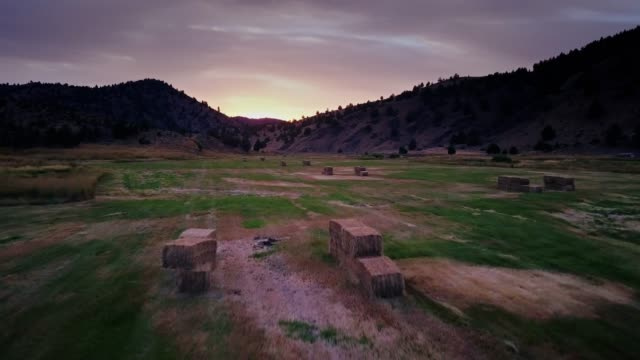 hay bales in oregon farmland - drone shot - west direction stock videos & royalty-free footage