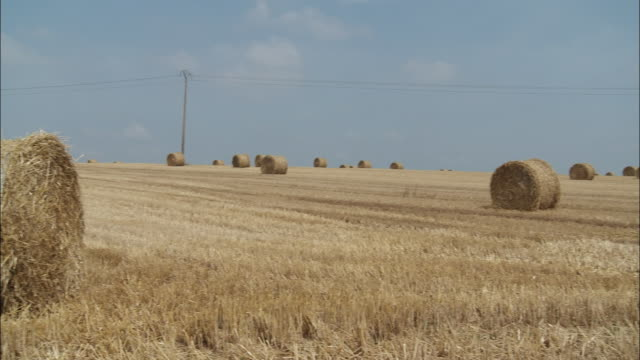 ws pan hay bales on field, reims, champagne, france - hay field stock videos & royalty-free footage