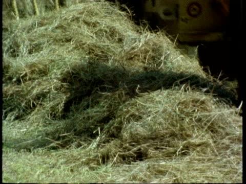 cu hay being baled, england, uk - hay baler stock videos & royalty-free footage