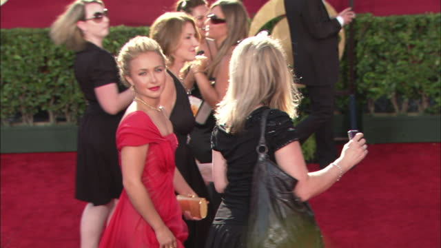 MCU Hayden Panettiere smiling and waving as she walks down red carpet