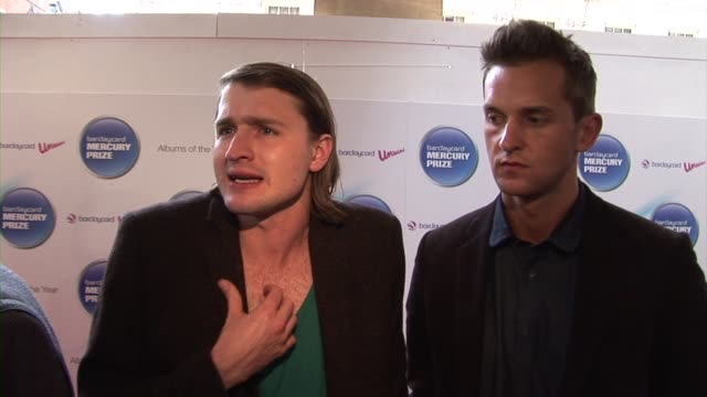 hayden thorpe, ben little of wild beasts on the judging process at the barclaycard mercury prize arrivals at london england. - スポーツの判定員点の映像素材/bロール