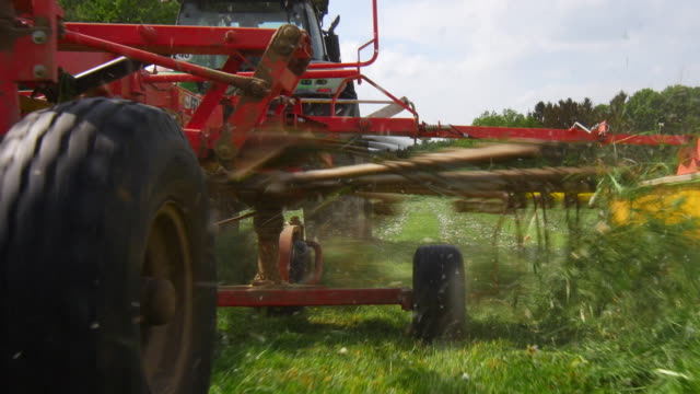 gimbal haymaking with tedder in spring pov (4k/uhd to hd) - tyre stock videos & royalty-free footage