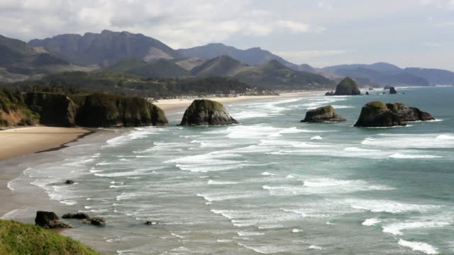 ls, haystack rock and cannon beach, oregon - cannon beach stock videos & royalty-free footage
