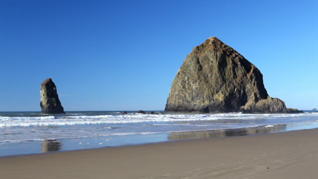 hd haystack rock in cannon beach oregon - cannon beach stock videos & royalty-free footage
