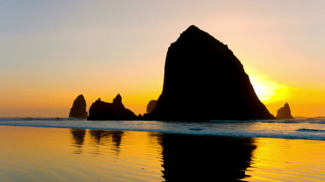 haystack rock on sunset - oregon coast stock videos and b-roll footage