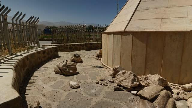 hazara minority fearful of future under taliban rule; afghanistan: bamiyan: ext various shots of holes in rockface where bamiyan buddhas were... - politics stock videos & royalty-free footage