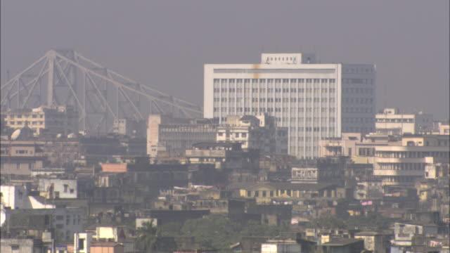 a haze covers downtown calcutta. - kolkata stock videos & royalty-free footage