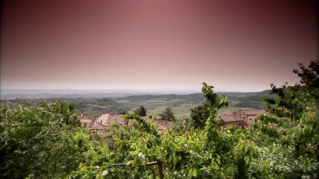 a haze fills the sky above montepulciano, tuscany. available in hd. - montepulciano stock videos & royalty-free footage
