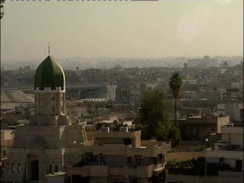 A haze hangs over the city of Mosul in Iraq.