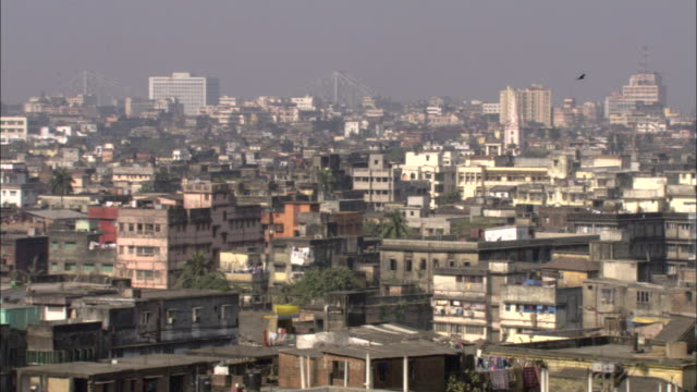 a haze hovers over a rundown neighborhood in calcutta. - kolkata stock videos & royalty-free footage