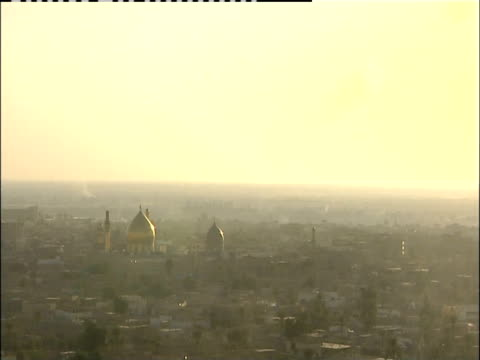 A haze hovers over the cityscape of Samarra, Iraq.