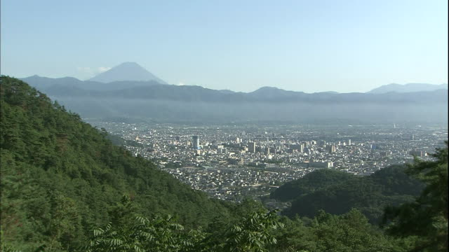 A haze shrouds Mount Fuji near Kofu City in Japan.