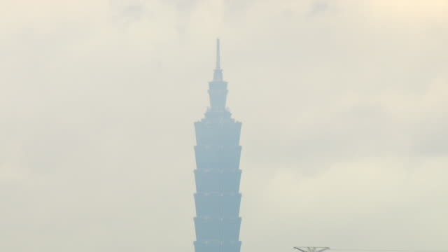 haze shrouds the taipei 101 skyscraper in hualien, taiwan. - taipei 101 stock videos & royalty-free footage