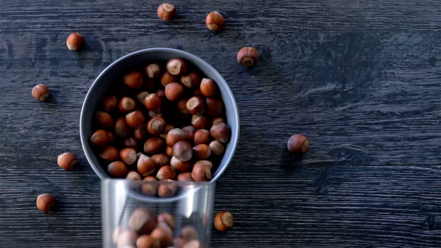 hazelnuts are fall out from a basket slow motion - nutshell stock videos and b-roll footage