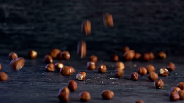 hazelnuts on rustic wooden background - nutshell stock videos & royalty-free footage